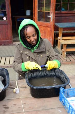 Rohana washing pottery
