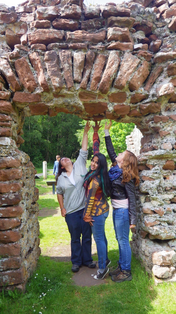 A doorway at the Ravenglass bathhouse with students for scale.