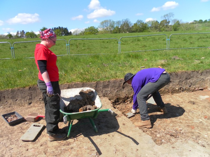 Meagan and Rob clear an area around a Roman oven. This was last used around 1800 years ago!
