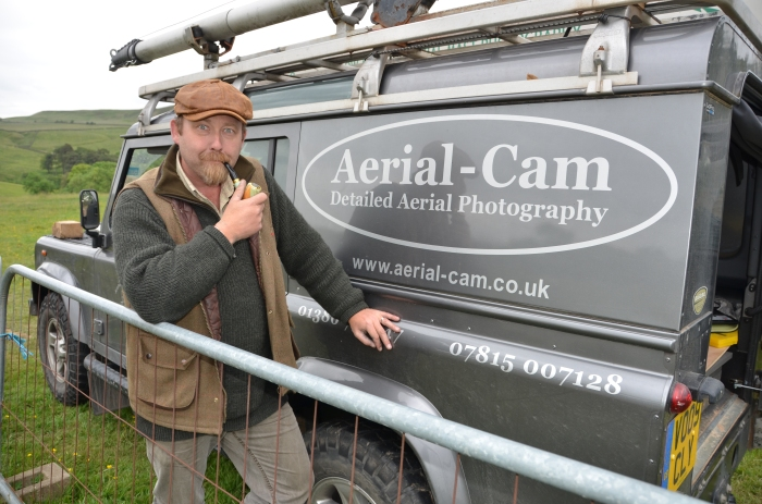 Adam Stanford and his very cool Aerial-Cam vehicle, with an equally cool pipe, a recent addition to his persona.