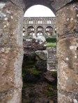 Jedburgh Abbey through an archway