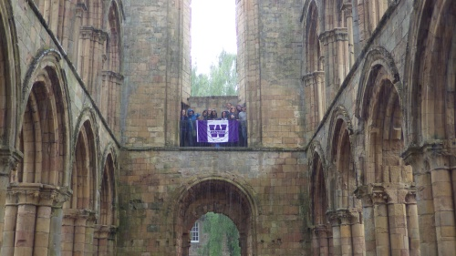 Up the balcony of the abandoned abbey at Jedburgh in Scotland. Do you see that rain???