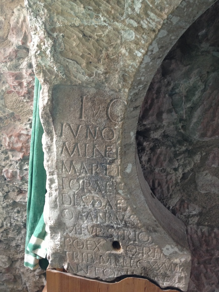 Part of a Roman altar which had been re-used as the lintel of a medieval doorway within the castle. The inscription is a dedication to Jupiter, Juno, ad other gods by a soldier from the Danube frontier, which is an example of the continuity of the material culture from the earlier ROman period.