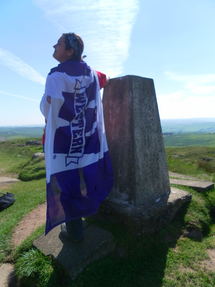 "Helping ""Western Girl"" launch herself in flight from the highest elevation point on Hadrian's Wall."