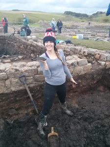 This is me holding a leather fragment. But this is a good picture to show how MUDDY this place is… but totally worth it.