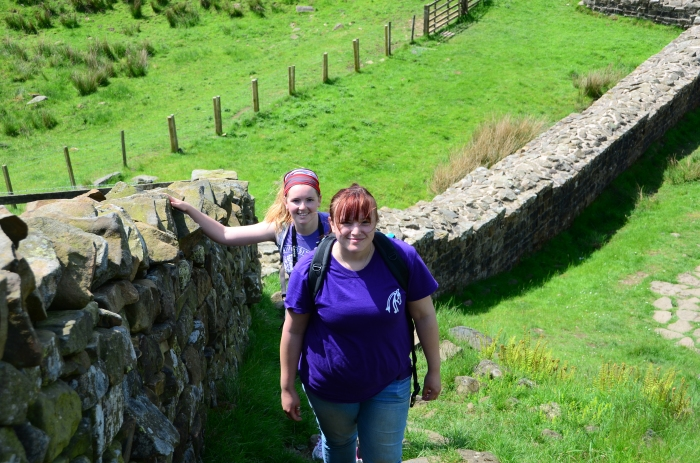 Emily and Sarah take a minute to enjoy one of the steepest climbs on the wall at Steel Rigg.