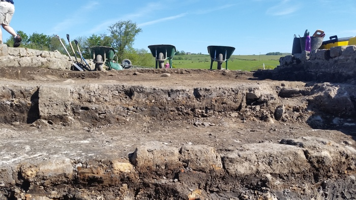 This picture perfectly shows the different context layers that my team has to dig through. The layer just below the wheelbarrows is where we worked today