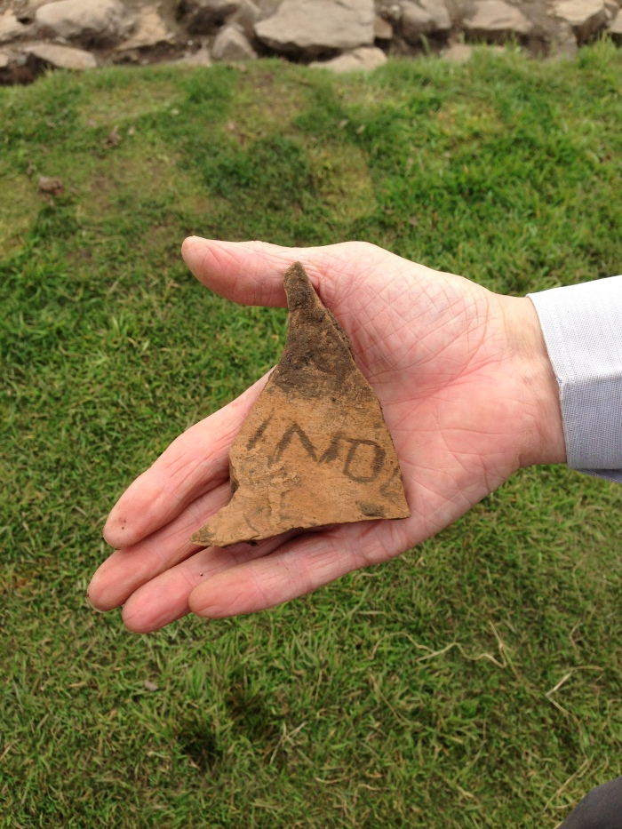 An inscribed piece of pottery found by Norman and Sarah in the rampart in the southeast corner of the fort. It appears to have the lettersv