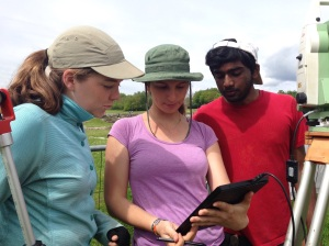 Marta showing Prem and Rachel the points they just marked using the total station.
